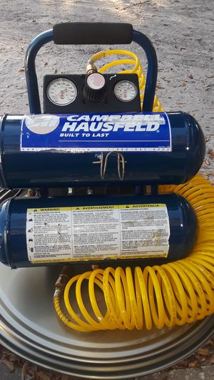 Two tank air compressor. With 25 ft coil air hose. for Sale in Auburndale, FL