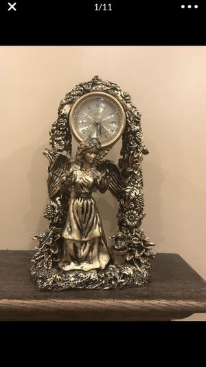 "Antique gold brass tabletop clock, it clicks and the dimensions are 14""x8"". Works great the only thing is one of the angels hands is broken but it's for Sale in Sterling Heights, MI"