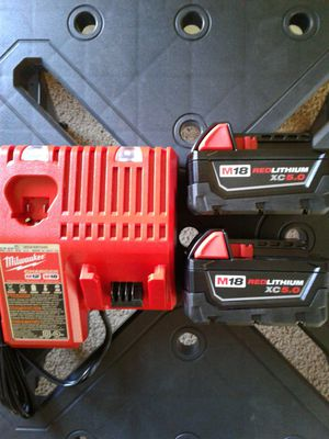 2 NEW MILWAUKEE M18 XC 5.0 BATTERIES AND CHARGER for Sale in Casa Grande, AZ