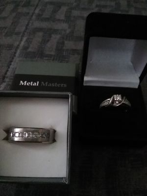 """MAN'S """" TITANIUM """" WEDDING BAND, AND LADIE'S ENGAGEMENT RING WITH REAL SMALL DIAMONDS. for Sale in Easton, MD"""