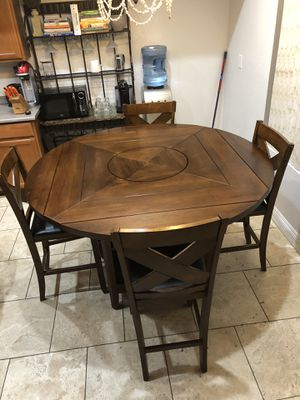Wood table in really good condition with six chairs, it has storage you can make it smaller or bigger. for Sale in Glendale, AZ