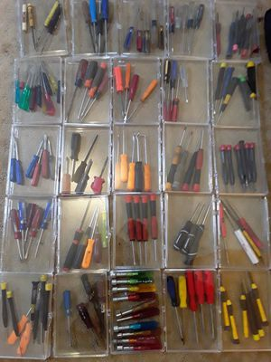 Used and new screw drivers drills beads concrete beads razor blades 80boxes many pieces for Sale in Oakland, CA