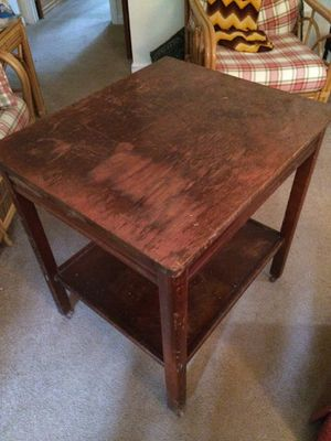 Table with shelf & small brass wheels for Sale in Cockeysville, MD