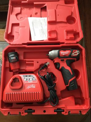 Milwaukee 12v 1/4 wrench 2 batteries and charger for Sale in San Diego, CA