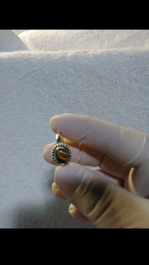 Brand new solid sterling silver and tigers eye women's ring size 7..stamped 925..smoke free home for Sale in Hemet, CA