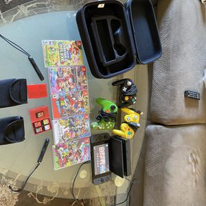 Black Nintendo Switch 5 Games 3 Controllers And A Travel Case for Sale in Baton Rouge, LA