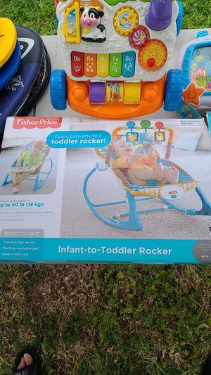 BRAND NEW INFANT/TODDLER ROCKER + TOYS for Sale in Miami Shores, FL