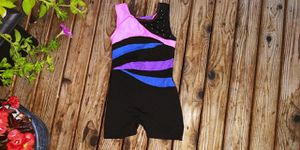 Freestyle girls size 6/6X black w/ diagonal colored stripes dance unitard for Sale in Tacoma, WA