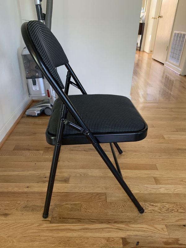 THREE black metal padded folding chairs