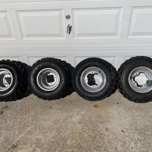 ATV rims and tires in good condition for Sale in Conyers, GA
