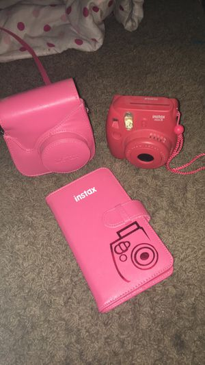 Pink Polaroid camera with mini photo album and camera holder for Sale in Fresno, CA
