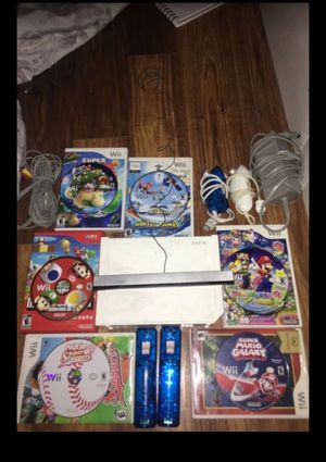 Wii with 5!! Mario games 2 handles an 2 nunchucks with all wires for Sale in Alexandria, VA