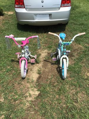 Frozen bicycles with training wheels for Sale in Coats, NC