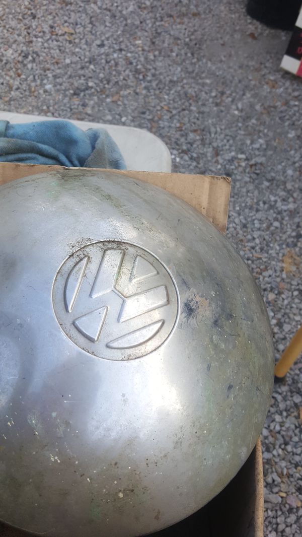 Vintage volkswagon hub caps and 2 light covers