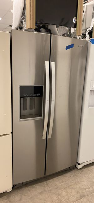 Whirlpool stainless steel side by side refrigerator for Sale in Bowie, MD