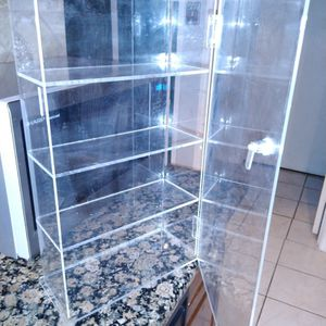 Clear 4 shelf display case $8 18 inches tall x 10 long x 5 wide for Sale in Missouri City, TX