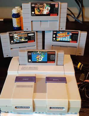 Clean super Nintendo system with 4 games for Sale in Fresno, CA
