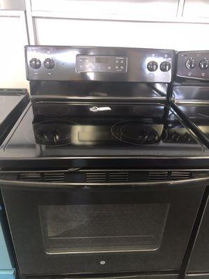 Used GE 4 burner glass top range. 1 year warranty for Sale in St. Petersburg, FL