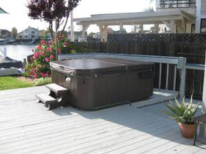 6 person top of line hot tub spa. 2019 floor model, Loaded!