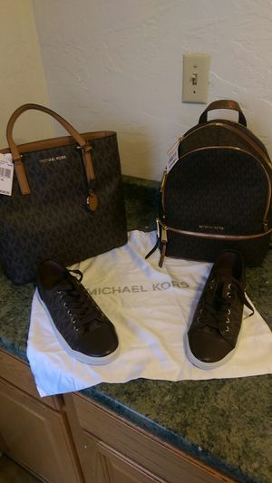 Brand new Michael Kors woman's bronze Morgan tote, woman's bronze backpack, in size 9 and 1/2 women's bronze sneakers for Sale in Bend, OR