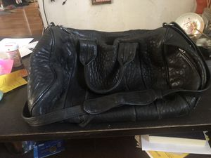 Alexander Wang Rocco Bag. Black with silver studs. Almost like new except a little rip in the inside of the strap from wear. Retails for almost $100 for Sale in San Diego, CA