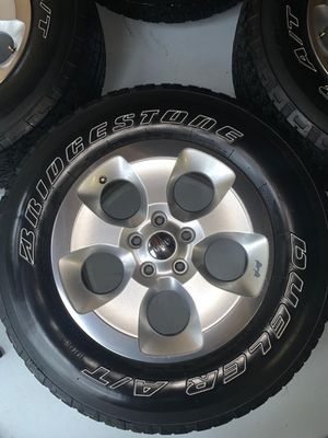 "18"" OEM Jeep Wrangler wheels and tires for Sale in Farmington Hills, MI"