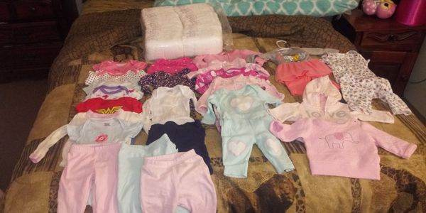 Newborn clothes size 2 diapers