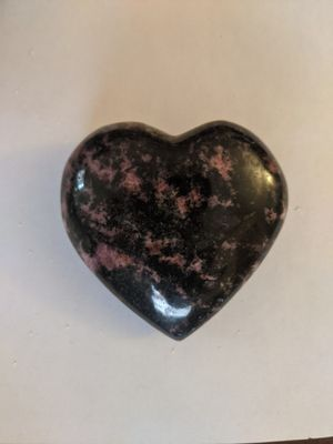 Rhodonite heart palm stone crystal for Sale in Clinton, MO
