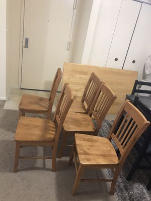 """Dining set heavy wood table 30""""x48"""" with 5 chairs smoke pet free available for pick up in Gaithersburg md20877 for Sale in Gaithersburg, MD"""