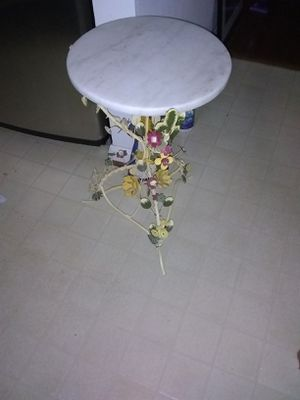 Metal with flower design marble top plant stand not light weight for Sale in Alexandria, VA