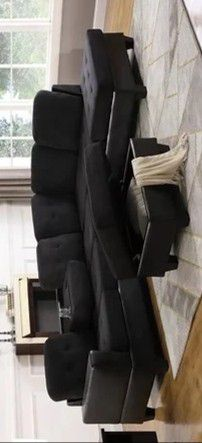 Park place black sectional with ottoman for Sale in Houston, TX