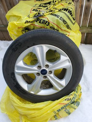 BUNDLE 235/55 R 17 rims, studs AND all season tires. Off ford escape for Sale in Fort Dodge, IA