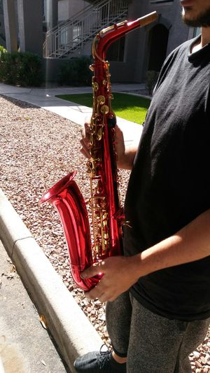BEAUTIFUL Cherry red saxaphone With carrying case and cleaner for Sale in Mesa, AZ