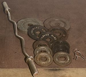 74 pounds of Olympic weights and curl bar with clips for Sale in Tampa, FL