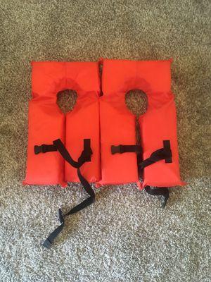Two children's life vests for Sale in Phoenix, AZ