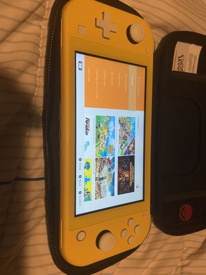 Nintendo Switch Lite with games and accessories for Sale in Los Angeles, CA