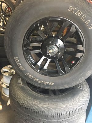 Set of 17 inch wheels with 4 matching tires for Sale in Nashville, TN