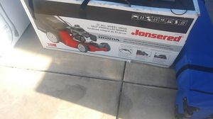 Lawn mower all-wheel drive new in the box powered by Honda motor $250 for Sale in Los Angeles, CA