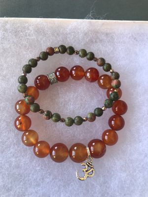 Carnelian with om charm and unakite stretch bracelets for Sale in Stockton, CA