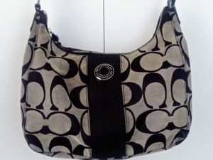 Coach Signature shoulder bag/ hobo black and taupe for Sale in Dallas, TX