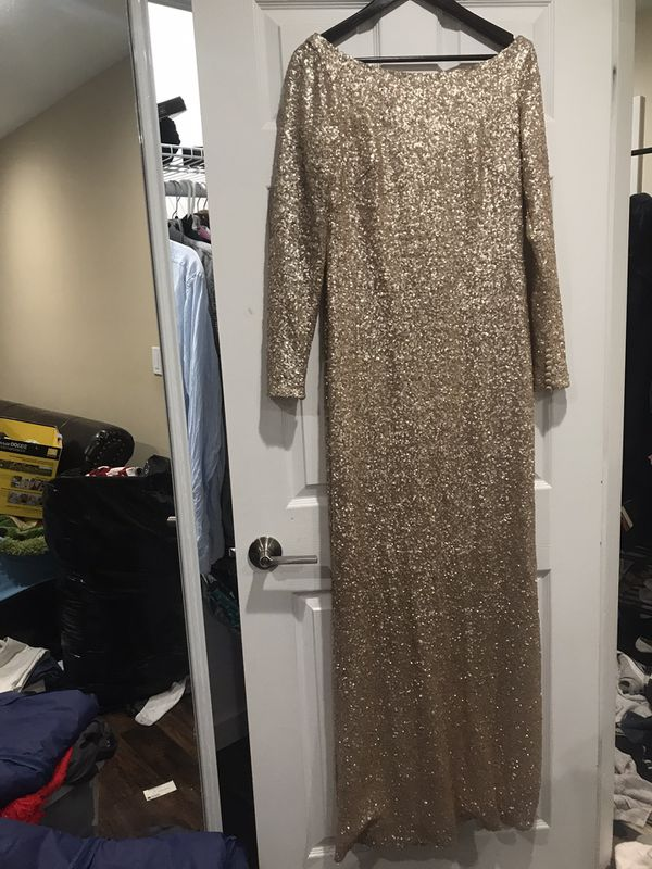 Gorgeous gold sequin dress. The most comfortable gown I've tried. Worn once for a Baptism party.