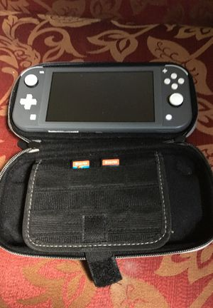 Nintendo switch lite..lookin to trade electronics or collectible action figures for Sale in Nashville, TN