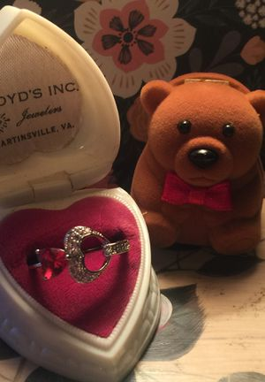 Beautiful two hearts ruby engagement ring one open silver with tiny sprays of little sparkly rubies size on sterling band sz8 Free Teddy Bear case for Sale in Northfield, OH