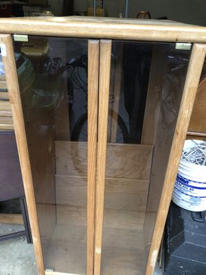 2 Wooden shelf with glass doors on casters for Sale in Woodruff, SC