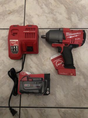 Milwaukee M18 FUEL ONE-KEY 18-Volt Lithium-Ion Brushless Cordless 1/2 in. Impact Wrench with Friction Ring charger and a 5.0 battery no bag $420 Ch for Sale in Lauderhill, FL