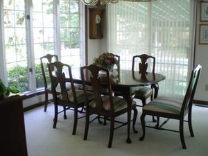 Cherry dinning table and china hutch (lighted) chairs and also have matching tea server and silver cabinet for Sale in Zanesville, OH