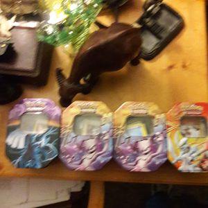 4 tins of Pokemon cards for Sale in Glendale, AZ