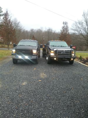 Ford f450 dually in the picture its the truck on the right for Sale in DuBois, PA