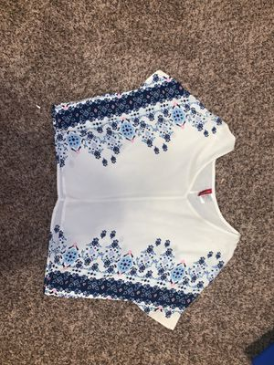 White flowy short in length top with blue detailing for Sale in San Angelo, TX