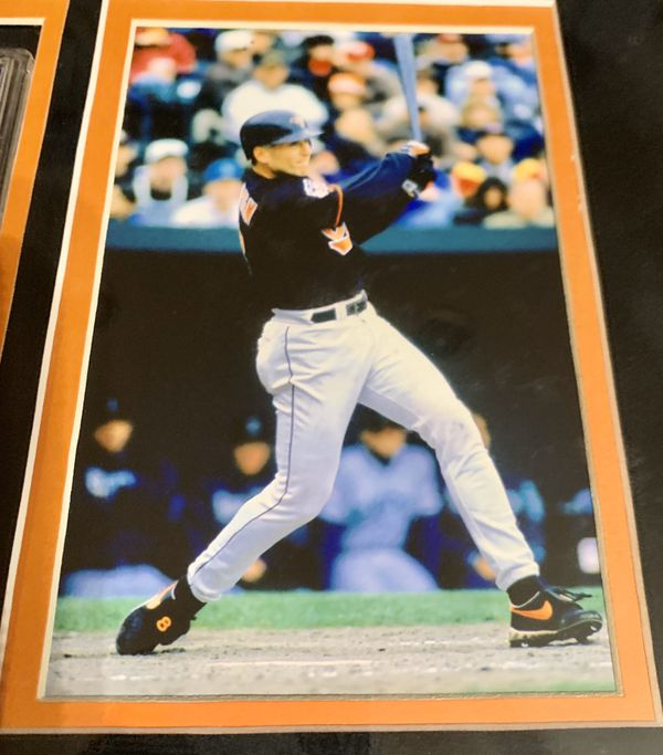 Cal Ripken Junior photo collage with autographed baseball card (certificate of authenticity included)